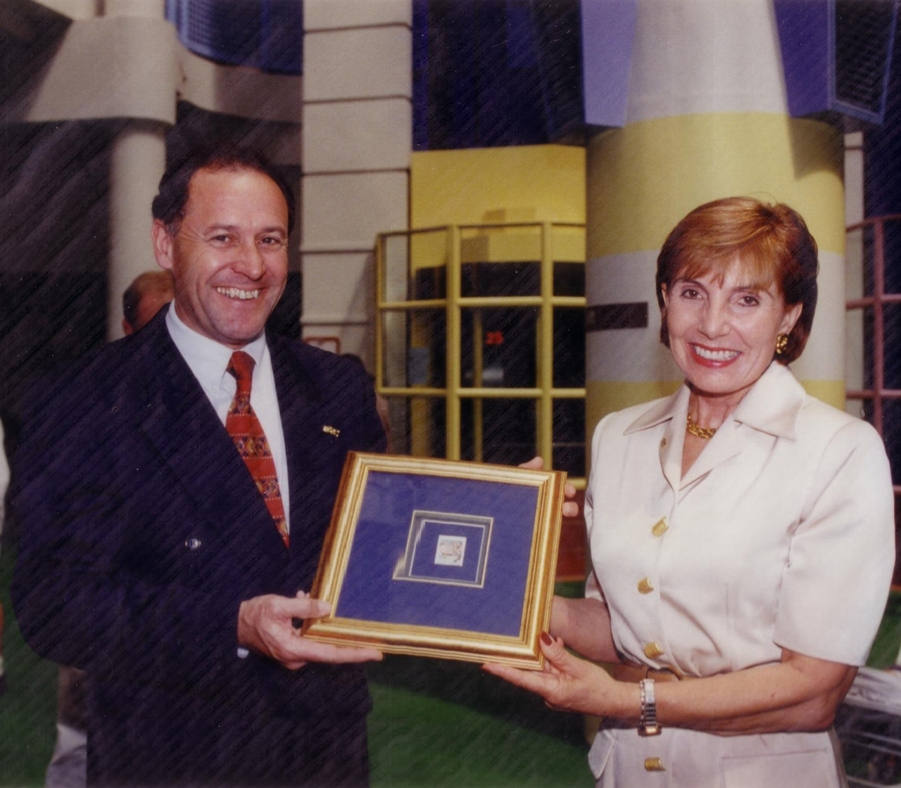 Dame Rosie pictured in 1996 with Sir Ralph Norris who presents a cheque on behalf of ASB.