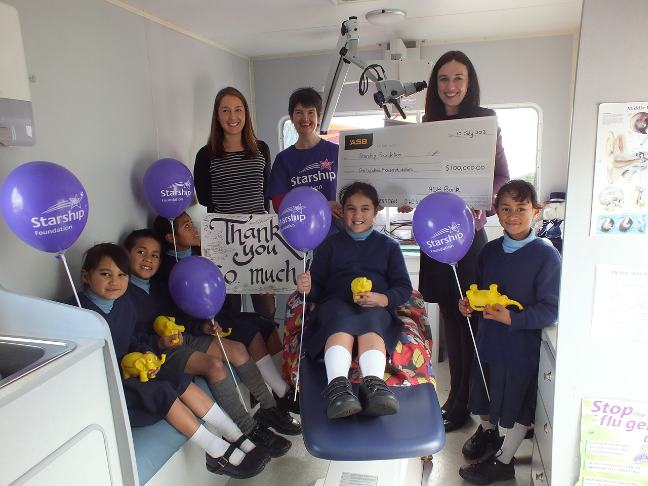 A look inside the mobile ear clinic as ASB present a cheque for $100,000 in 2013.